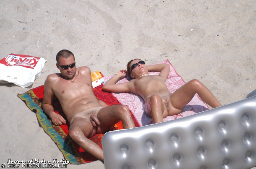 Naturist Beach Husband & Wife Sunbathing