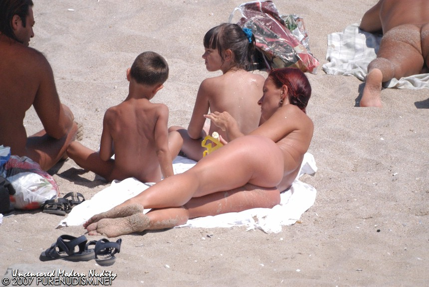 two-moms-with-child-beach.jpg